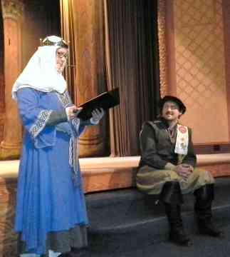 Baroness Gwen reciting a sonnet to Don Orlando for his birthday. Photo by Arianna of Wynthrope
