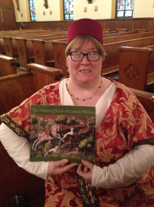 Fiona the prepared, with the Gaston Phoebus volumes she uses to discuss hounds coursing.