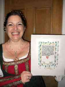 Lady Teresa Alvarez, who made Queen Anna Leigh's garb, was inducted into the Order of the Sycamore. Photo by Mistress Hilderun Hugelmann.