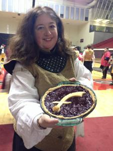 Duchess Dorinda with a boysenberry pie made for her by Master Urho Walterrinen. Photo by Lady Fiora d'Artusio.