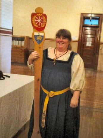 THLady Hrefna Ulfvarinnsdottir, Kingdom Historian, with the Great Spoon of Æthelmearc. Photo by Arianna.