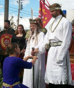 Baroness Nuzha swearing fealty to Khalek and Branwen as head retainer