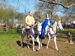 "TRM riding in the Grand Procession at Gulf Wars, on ""Otto"" and ""Zia,"" the steeds of Mistress Arabella da Seina. Photo by Barbarossa."