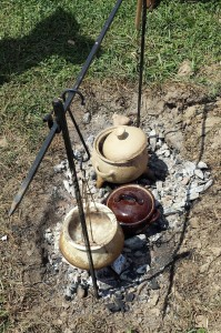 Cooking over coals in period-style ceramic pots