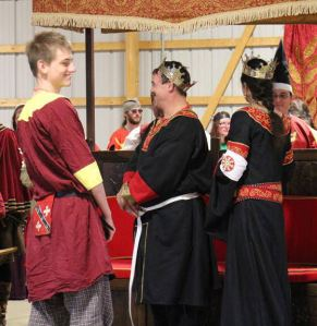 Lord Thorstein receiving his Golden Alce. Photo by Master Alaxandair O'Conchobhair.