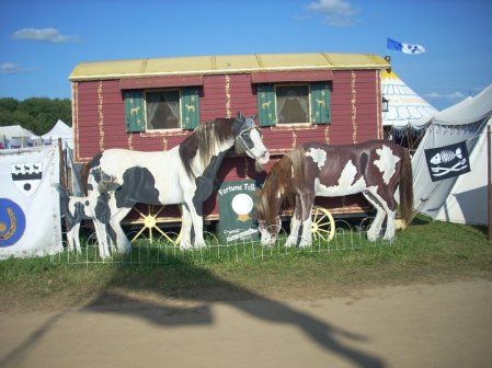 Terrific Gypsy Vardo wagon with beautiful  tromp l'oiel horses and dogs, is always a favorite of children. The arrangement is changed every day to make a story of animal life, as Pennsic unfolds. Photo credit, Aoife.
