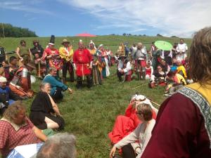Foreground: Sir Wulfstan the Unshod speaks as a member of the Chivalry.