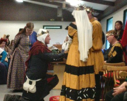 Duke Christopher swears fealty as Kingdom Seneschal. Photo by Mistress Arianna.