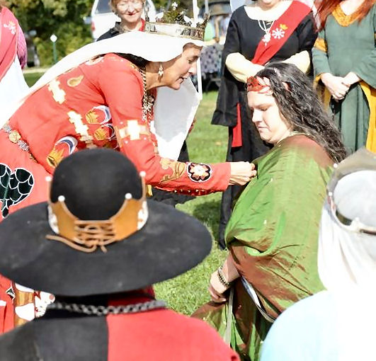 Mistress Felicitas is inducted into the Millrind. Photo by Baron Steffan.