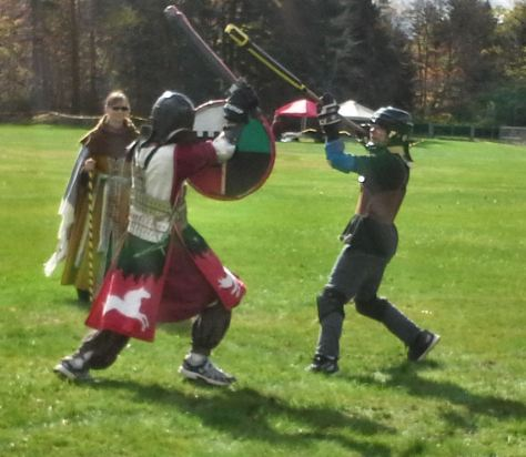 Ulfr vs. Danny in the Baronial Youth Combat CHampion's Tourney. Photo by Arianna.