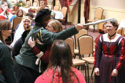 Dona Katherine being greeted by Mistress Illadore and the rest of the Order of the Fleur