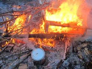 Bonfire ready to go, kiln steadily venting steam.
