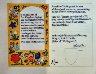 Lady Aurelie's AoA scroll by THLady Eleanor Godwin. Photo by Jinx.