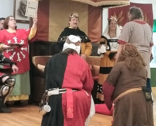 THLord Grimolf is inducted into the White Horn. Photo by Mistress Arianna.