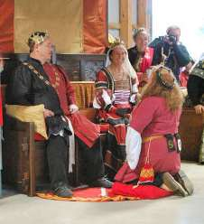 Baroness Anna receives a Writ for a Laurel. Photo by Lady Aine.