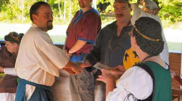 Lord Chebe receives his AoA. Photo by Lord Mikus Magellus.
