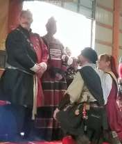 Lord Duncan and Lady Isabella receive their AoAs. Photo by Mistress Arianna of Wynthrope.
