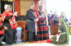 Mistress Fredeburg receives a Writ for the Order of Defense. Photo by Lady Aine ny Allane.