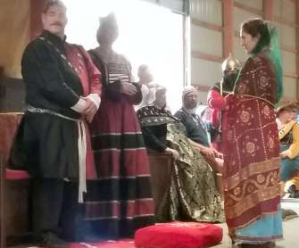 Lady Illyria receives her AoA. Photo by Mistress Arianna.