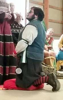 Lord Nicolo receives a Keystone. Photo by Mistress Arianna.