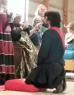 Lord Salvador receives his AoA. Photo by Mistress Arianna.