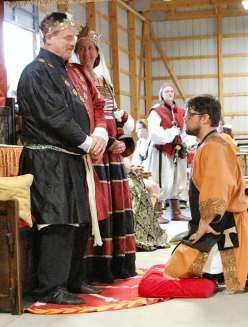 Lord Theowulf receives his Golden Alce. Photo by Lady Aine.