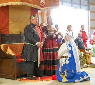 Mistress Yvianne receives a Court Barony. Photo by Lady Aine ny Allane.