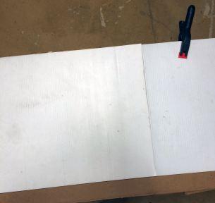 Coroplast clamped to cardboard