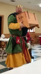 Baron Cormacc flees with the toy chest before the children can catch him.