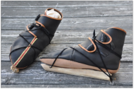 Embroidered shoes on bone ice skates