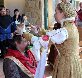 Anna Leigh crowns Gareth King. Lady McKenna is inducted as a Principal of the Order of the Howling Wolf. Photo by Master Alaxandair.