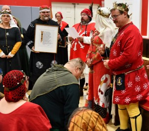 Lord Matheus receives a Millrind. Photos by Baron Steffan.